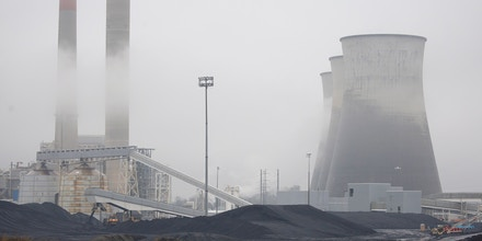 A Caterpillar Inc. bulldozer drives past the Tennessee Valley Authority Paradise Fossil Plant, a generating station that used to burn coal mined by Murray Energy Holdings Co., in Paradise, Kentucky, U.S., on Wednesday, Oct. 30, 2019. Murray Energy, the largest privately owned U.S. coal company, filed for Chapter 11 protection in the U.S. Bankruptcy Court in Columbus, Ohio, to restructure more than $2.7 billion of debt. Photographer: Luke Sharrett/Bloomberg via Getty Images