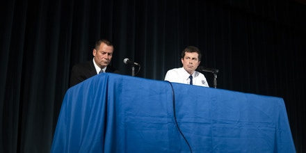 Mayor Pete Butti­gieg, a Democ­ratic presidential hopeful, right, joined by Scott Ruszkowski, the South Bend police chief, during a town-hall-style event in South Bend, Ind., on June 23, 2019. The fatal shooting last week of a black man by a South Bend police officer has tested Buttigieg's leadership at a critical time for his campaign. (Mark Felix/The New York Times)