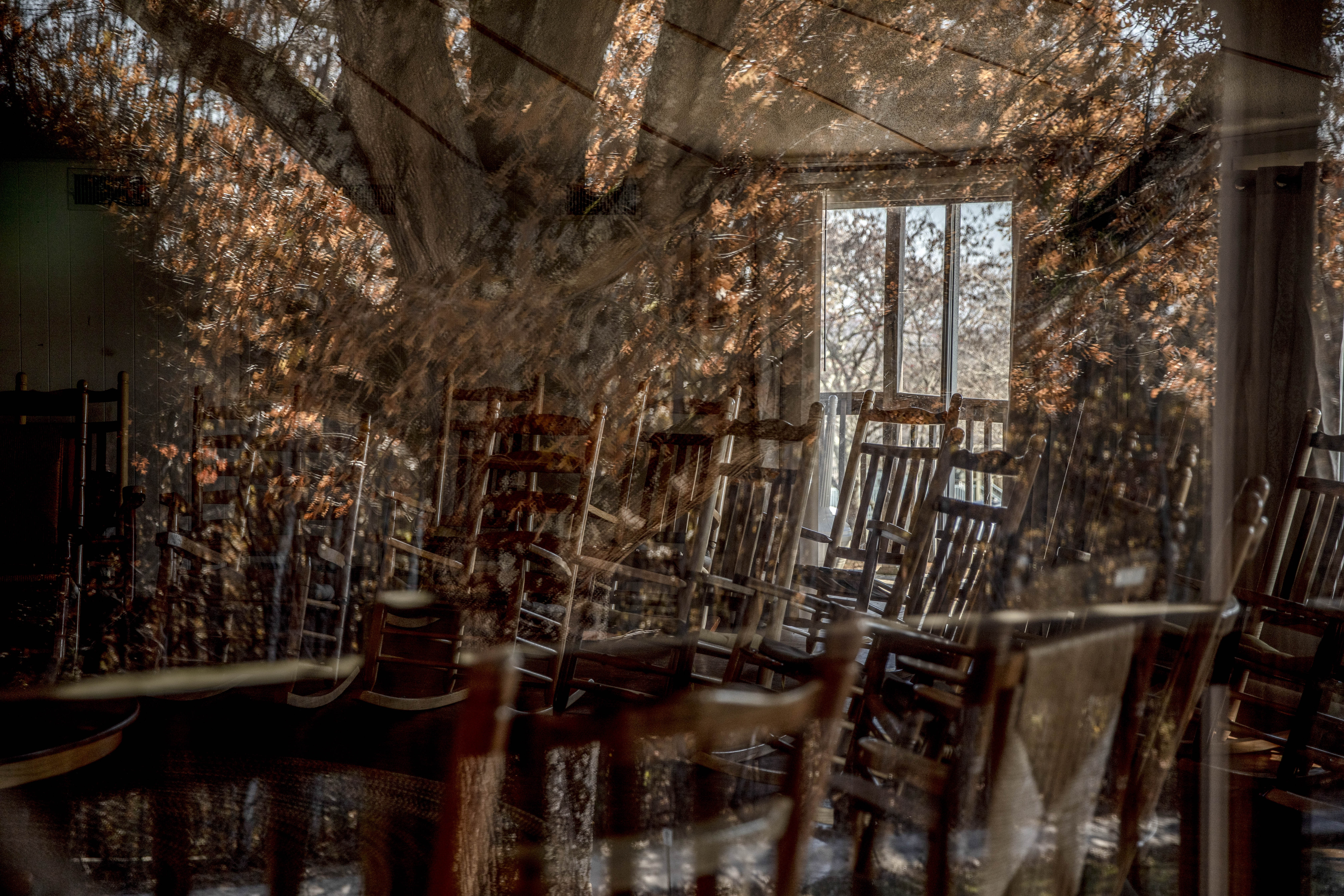 November 18, 2019 - New Market , TN: The workshop space at the Highlander Research and Education Center as seen through a glass reflecting trees outside. .