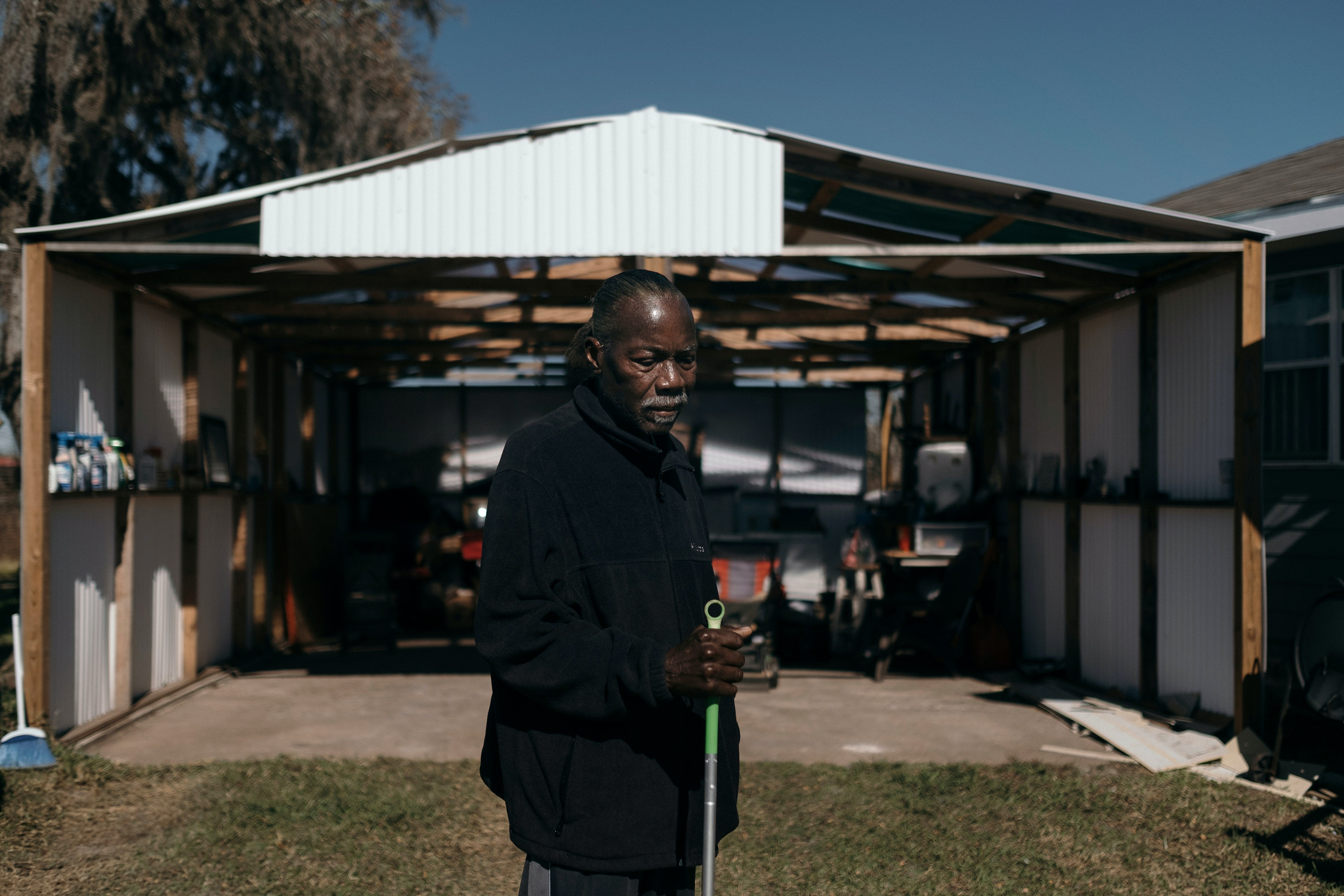 Clarence Thompson stands outside of his Brazoria, Texas home assisted by a walking stick, on Wednesday, December 18th, 2019.Todd Spoth for The Intercept.