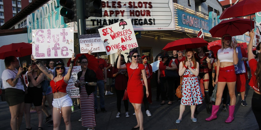 People chant as they march in support of sex workers, Sunday, June 2, 2019, in Las Vegas. People marched in support of decriminalizing sex work and against the Fight Online Sex Trafficking Act and the Stop Enabling Sex Traffickers Act, among other issues. (AP Photo/John Locher)