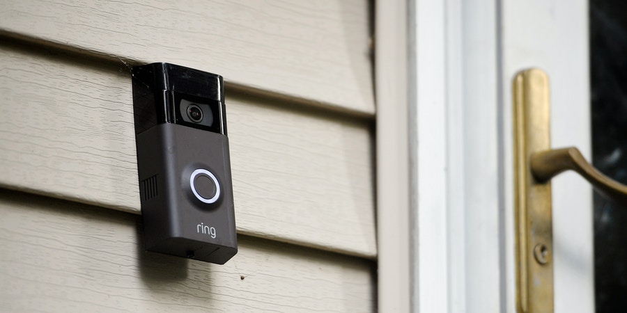 In this Tuesday, July 16, 2019, photo, a Ring doorbell camera is seen at a home in Wolcott, Conn. A group of Democratic U.S. senators is questioning Amazon about the security of its Ring doorbell cameras following reports that some Ukraine-based employees had access to video footage from customers' homes. (AP Photo/Jessica Hill)