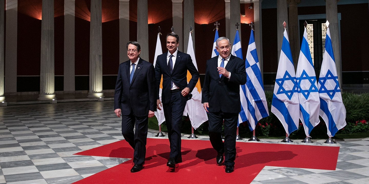 Greece's Prime Minister Kyriakos Mitsotakis, center, Cypriot President Nicos Anastasiadis, left, and Israeli Prime Minister Benjamin Netanyahu walk towards a hall for a signing ceremony in Athens, Thursday, Jan. 2, 2020. The leaders of Greece, Israel and Cyprus met in Athens Thursday to sign a deal aiming to build a key undersea pipeline, named EastMed, designed to carry gas from new rich offshore deposits in the southeastern Mediterranean to continental Europe. (AP Photo/Yorgos Karahalis)