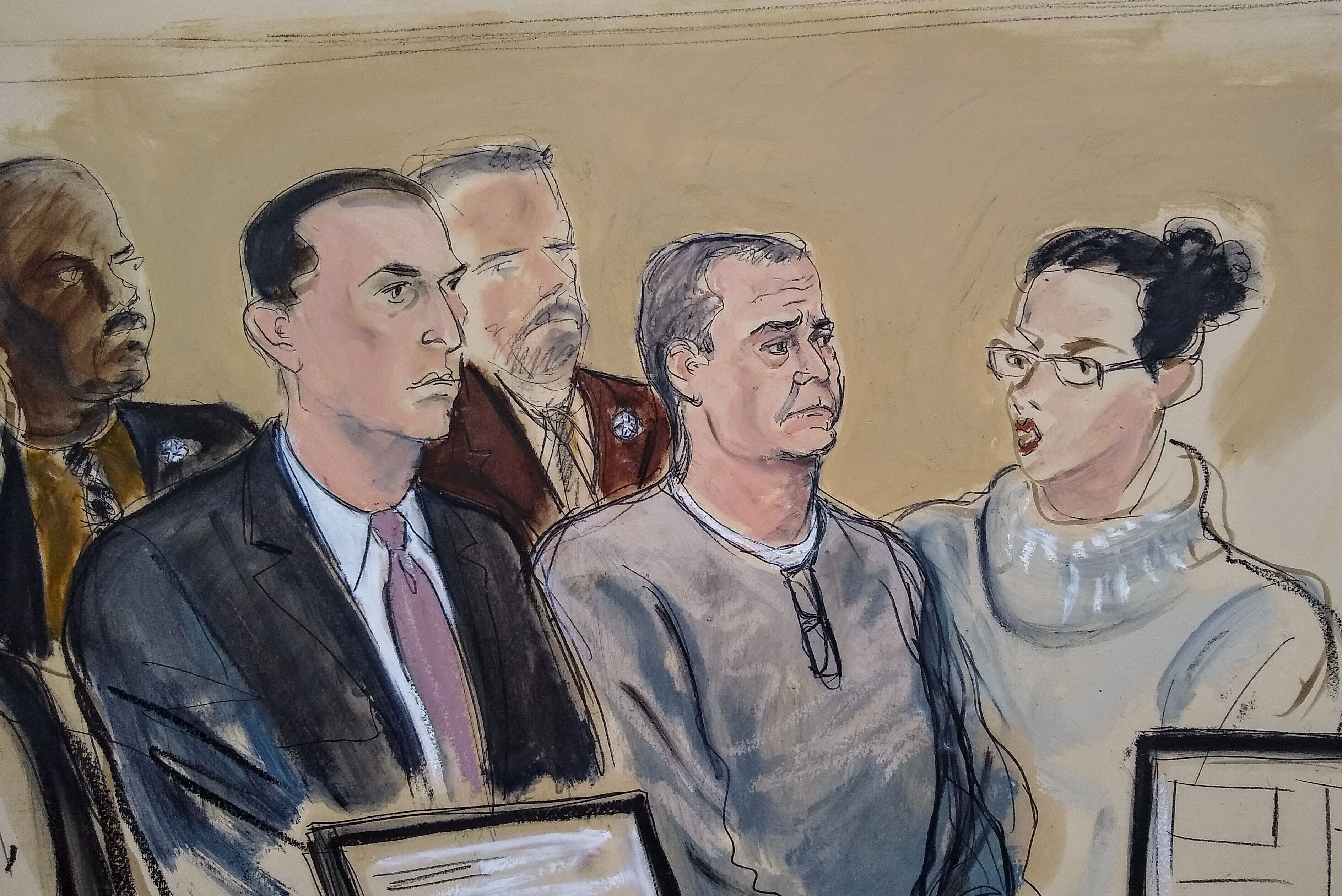 "In this courtroom sketch, defense attorney Cesar de Castro, left, Mexico's former top security official Genaro Garcia Luna, center, and a court interpreter, appear for an arraignment hearing in Brooklyn federal court Friday, Jan. 3, 2020, in New York. Garcia Luna pleaded not guilty to charges he accepted a fortune in drug-money bribes from kingpin Joaquin ""El Chapo"" Guzman's notorious Sinaloa cartel. (AP Photo/Elizabeth Williams)"