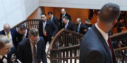Secretary of State Mike Pompeo, center, walks with Defense Secretary Mark Esper, to the left of Pompeo, as they leave a briefing of Senators on the details of the threat that prompted the U.S. targeted killing of Iranian Gen. Qassem Soleiman in Iraq, Wednesday, Jan. 8, 2020, on Capitol Hill in Washington. (AP Photo/ Jacquelyn Martin)