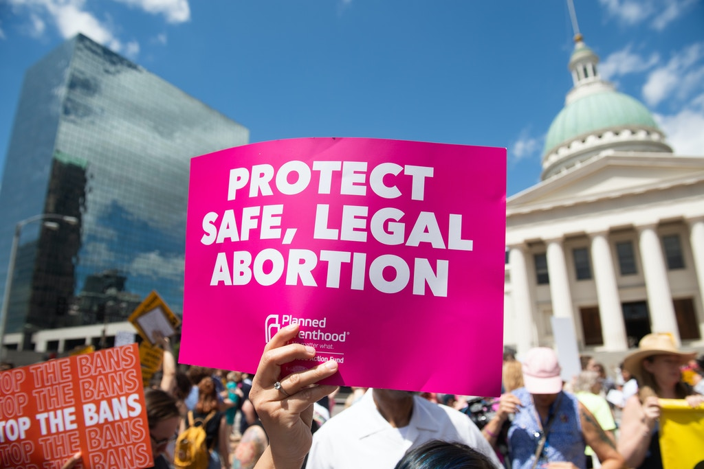 Protesters hold signs as they rally in support of Planned Parenthood and pro-choice and to protest a state decision that would effectively halt abortions by revoking the center's license to perform the procedure, near the Old Courthouse in St. Louis, Missouri, May 30, 2019. (Photo by SAUL LOEB / AFP)        (Photo credit should read SAUL LOEB/AFP via Getty Images)