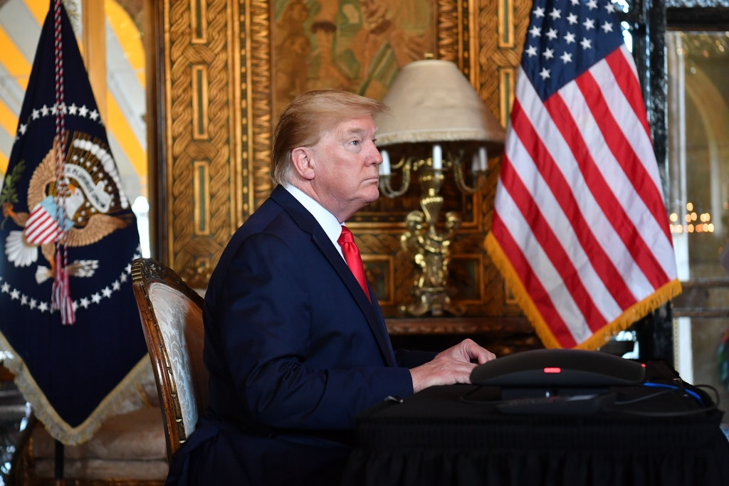 US President Donald Trump makes a video call to the troops stationed worldwide at the Mar-a-Lago estate in Palm Beach Florida, on December 24, 2019. (Photo by Nicholas Kamm / AFP) (Photo by NICHOLAS KAMM/AFP via Getty Images)