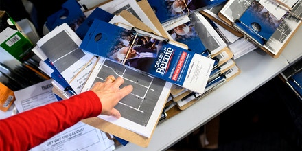 A volunteer points to canvassing materials at the Bernie Sanders presidential campaign field office in Cedar Rapids, Iowa, on Jan. 25, 2020.