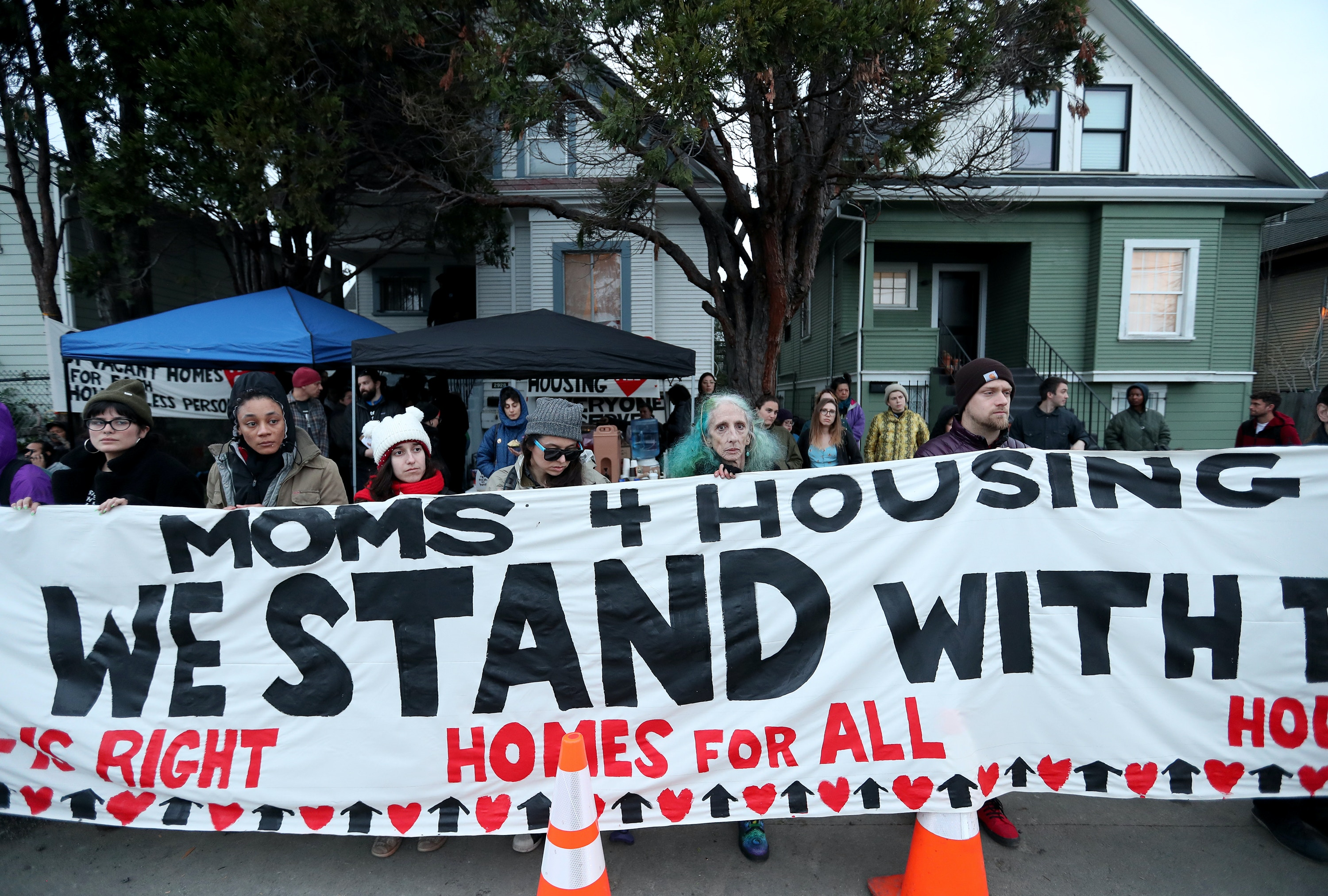 OAKLAND, CA - JANUARY 13: Moms 4 Housing supporters protest in front of a vacant house in West Oakland, Calif., on Monday, January 13, 2020. Members of the group have been illegally occupying the home since November to bring attention to affordable housing issues. (Jane Tyska/Digital First Media/East Bay Times via Getty Images)