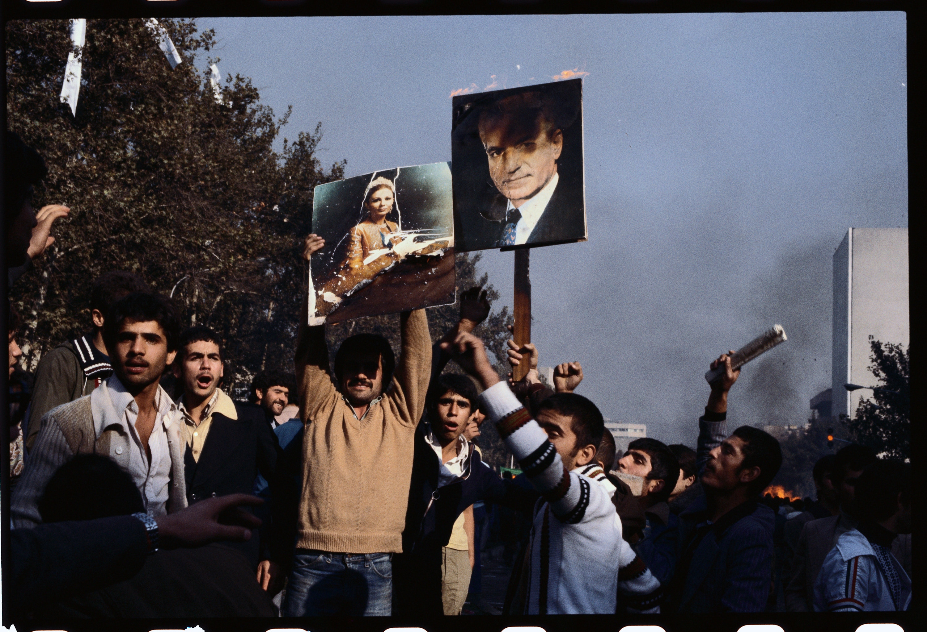Young men protest against the government of the current Shah, Mohammed Reza Pahlavi. The Shah's government was overthrown in October in favor of an Islamic government led by Ruhollah Khomeini. (Photo by michel Setboun/Corbis via Getty Images)