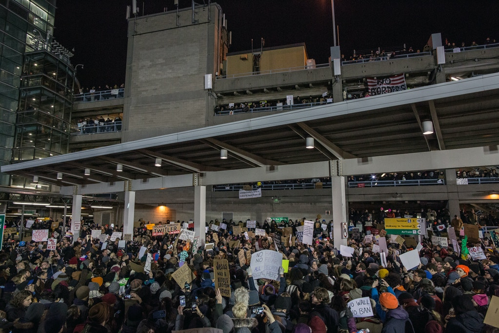 NEW YORK, NY - JANUARY 28: Protestors rally during a demonstration against the Muslim immigration ban at John F. Kennedy International Airport on January 28, 2017 in New York City. President Trump signed an executive order to suspend refugee arrivals and people with valid visa from Iran, Iraq, Libya, Somalia, Sudan, Syria and Yemen. (Photo by Maite H. Mateo/Corbis via Getty Images)