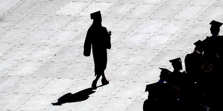 BOSTON, MA - MAY 21: A graduate is silhouetted during the Boston College commencement at Alumni Stadium in Boston on May 21, 2018. (Photo by David L. Ryan/The Boston Globe via Getty Images)