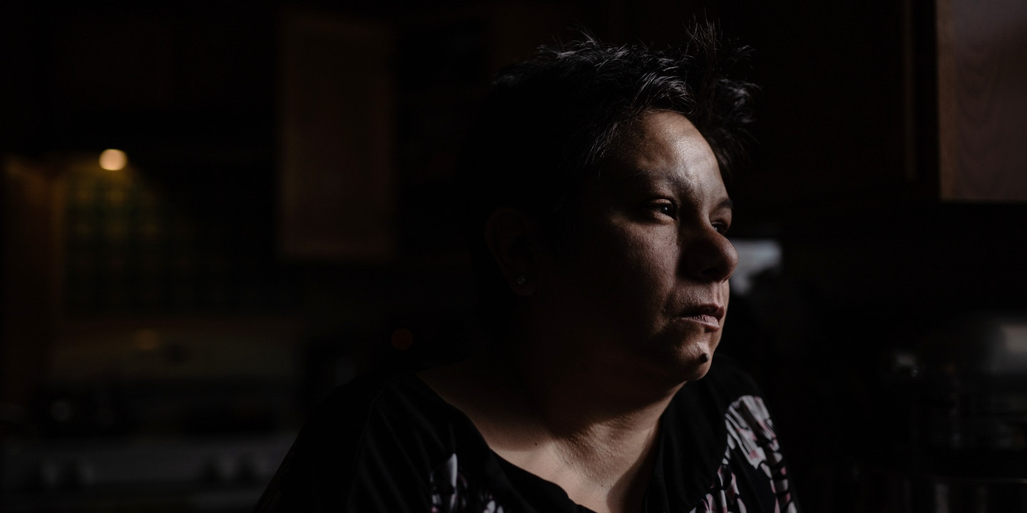Angela Ramirez looks out the window of her home in Waukegan, Ill. on Jan. 2, 2020. Ramirez, who was diagnosed with breast cancer, lives less than six miles away from two factories that emit ethylene oxide, a gas known to cause cancer. Pat Nabong for The Intercept.