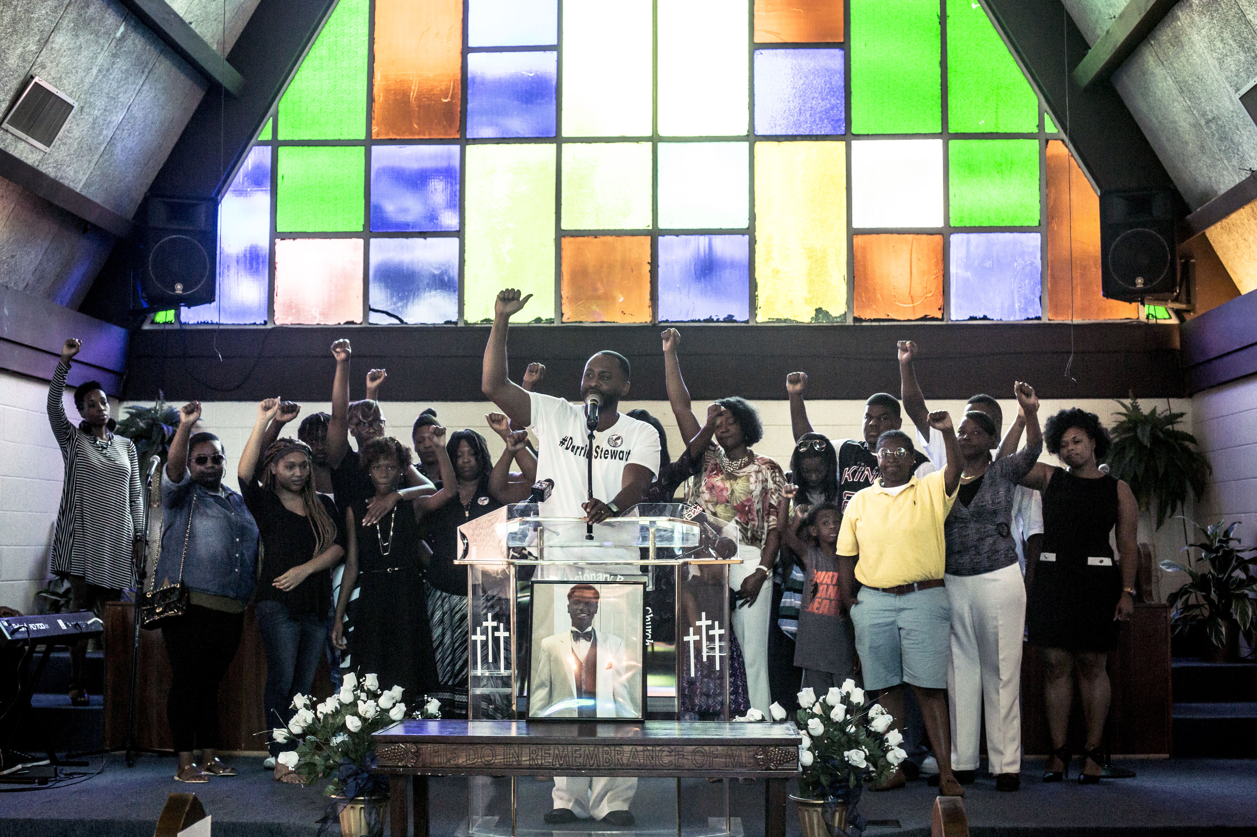 July 17, 2016 - Memphis, TN: Pastor Earle Fisher (center) stands with the family of Darrius Stewart, a 19-year-old-black man who was killed during a traffic stop in July 2016. Stewart's photograph is at the pulpit. Stewart's mother, Mary, was also included on the black list for city hall.
