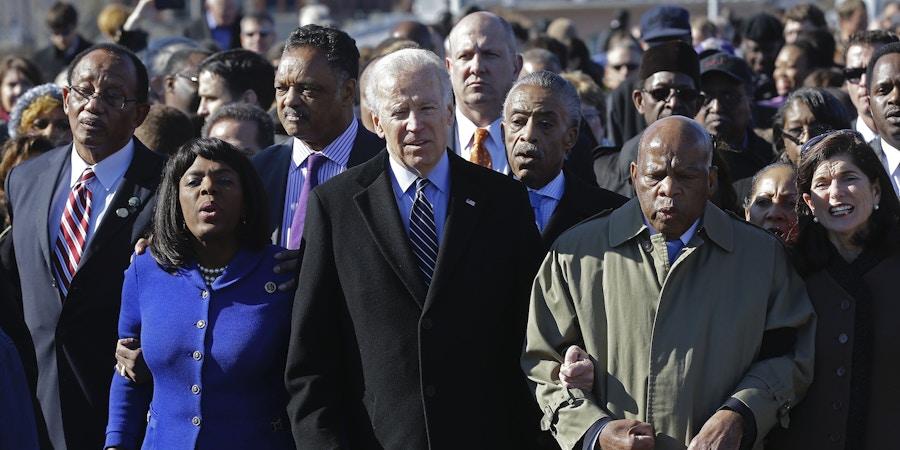 Vice President Joe Biden, center, leads a group across the Edmund Pettus Bridge in Selma, Ala., Sunday, March 3, 2013. They were commemorating the 48th anniversary of Bloody Sunday, when police officers beat marchers when they crossed the bridge on a march from Selma to Montgomery. From left: Selma Mayor George Evans, U.S. Rep. Terri Sewell, D-Ala., Rev. Jesse Jackson, Biden, Rev. Al Sharpton and U.S. Rep. John Lewis, D-Ga. (AP Photo/Dave Martin)