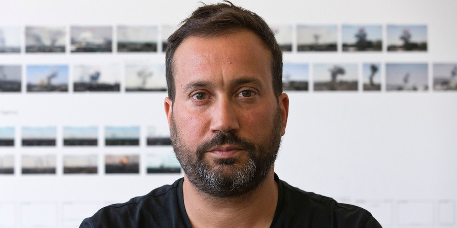 Principal Investigator Eyal Weizman poses for a photograph in his office at Goldsmiths, University in London on August 26, 2016.Human rights campaigners Amnesty International are the latest organisation to call on Forensic Architecture's (FA) expertise. Its interdisciplinary laboratory specialises in producing analysis and evidence to be used in human rights cases brought to international courts, with architecture a key tool in helping to accurately recreate events occurring in chaotic surroundings. / AFP / JUSTIN TALLIS / TO GO WITH AFP STORY BY MYRIAM BENEZZAR (Photo credit should read JUSTIN TALLIS/AFP via Getty Images)