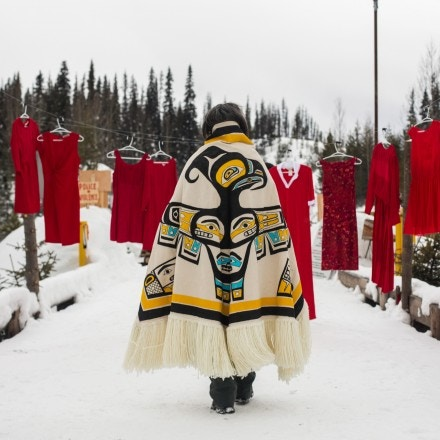 Ts'akë ze' Howihkat, Freda Huson, passes an installation of red dresses as she waits for police to enforce Coastal GasLink's injunction at Unist'ot'en Healing Centre near Houston, B.C. on Sunday, February 9, 2020. The red dresses are meant to represent the thousands of missing and murdered Indigenous women and girls, and to make the point that Indigenous people are over policed but under-protected.