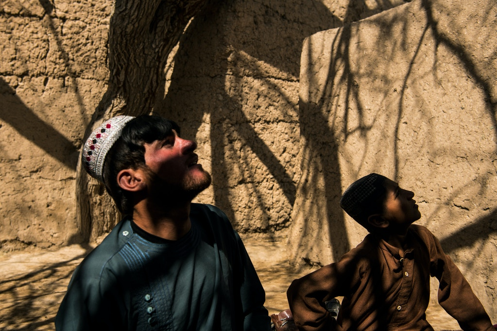 Rafiullah and Shamsullah whose family house was struck by an American A-10 aircraft in November 2018, resulting in the death of two and serious injury to 11 family members, including Shamsullah, look to the sky upon hearing the roar of jet aircraft in the sky above Loy Manda, outside Helmand's capital Lashkar Gah, on the third day of a week-long reduction in violence (RIV) agreement between the Taliban, the Afghan government and U.S. forces in Afghanistan. The period has been marked by a relaxed atmosphere that has seen local residents out and about on streets that would ordinarily be all but abandoned.