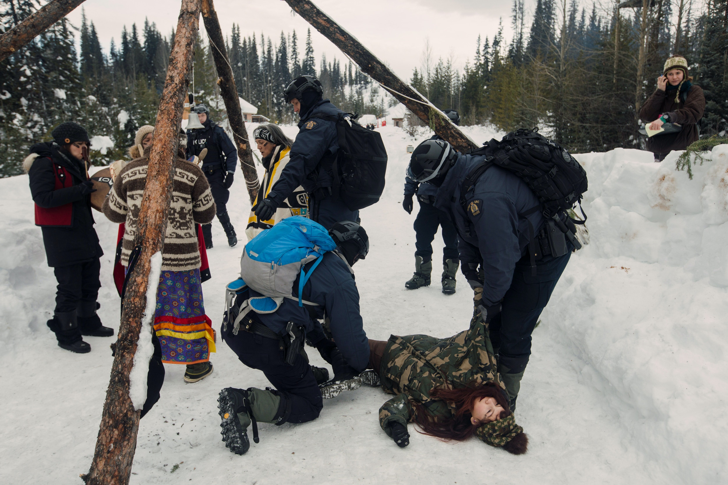 Nlaka'pamux supporter Autumn Walken goes limp as she is arrested at Unist'ot'en Healing Centre near Houston, B.C. on Monday, February 10, 2020. Five women and one man stood in ceremony on the road, in defiance of Coastal GasLink's injunction to force access to the unceded territory. Amber Bracken