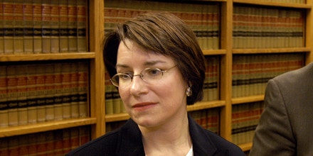 Hennepin County Attorney Amy Klobuchar, left, and prosecutor Alan Harris talk with reporters, Thursday, April 3, 2003, in Minneapolis after former Minnesota Twins play Kirby Puckett was found not guilty in the alleged sexual assault of a woman in a restaurant bathroom last September. (AP Photo/bill alkofer)