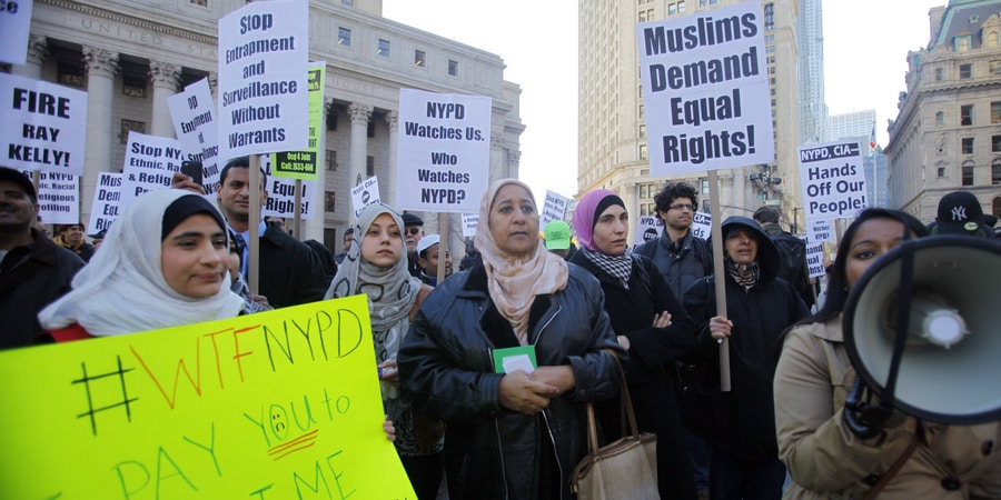 Muslim community and supporters protest the NYPD  surveillance operations of Muslim communities during a rally in Foley Square on Friday, Nov. 18, 2011, in New York.  Hundreds of Muslims gathered in prayer Friday to oppose a decade of police spying on Muslim communities. The crowd filled about three-fourths of Foley Square in lower Manhattan, not far from City Hall. Demonstrators were scheduled to march on police headquarters. (AP Photo/Bebeto Matthews)