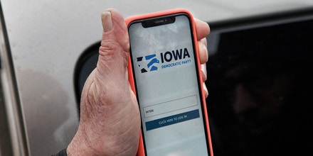 Precinct captain Carl Voss of Des Moines displays the Iowa Democratic Party caucus reporting app on his phone outside of the Iowa Democratic Party headquarters in Des Moines, Iowa, Tuesday, Feb. 4, 2020. (AP Photo/Nati Harnik)