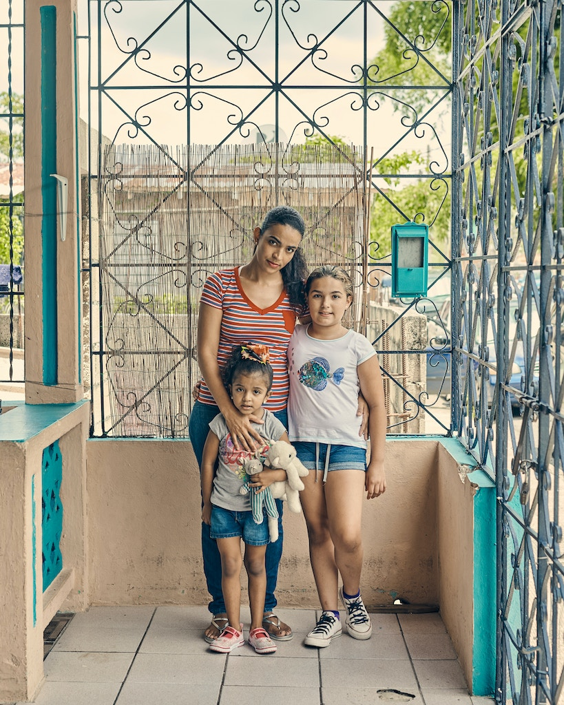 Adjuntas, Puerto Rico - 8/8/19: Shándia Perez with her daughter Aleysha age 4 and Daish age 10. Casa Pueblo installed solar panels in her house. Casa Pueblo has teamed with the Honnold Foundation to energize the town center as proof that small solar grids are a sustainable way to relieve dependence on fossil fuels.CREDIT: Christopher Gregory for The Intercept
