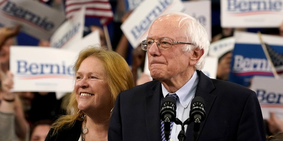 Democratic presidential hopeful Vermont Senator Bernie Sanders (R) arrives, flanked by his wife Jane O'Meara Sanders to speak at a Primary Night event at the SNHU Field House in Manchester, New Hampshire on February 11, 2020. - Bernie Sanders won New Hampshire's crucial Democratic primary, beating moderate rivals Pete Buttigieg and Amy Klobuchar in the race to challenge President Donald Trump for the White House, US networks projected. (Photo by TIMOTHY A. CLARY / AFP) (Photo by TIMOTHY A. CLARY/AFP via Getty Images)
