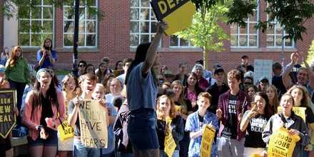 Quincy Abramson, center, speaks to a crowd about the power of the youth vote at the Climate Strike at the University of New Hampshire on Sept. 20, 2019.