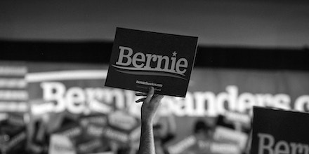 Supporters of Sen. Bernie Sanders hold signs during a campaign watch party event in Des Moines, Iowa, on Feb. 3, 2020.