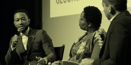 John Legend, left, in conversation with Patrisse Cullors and Mehdi Hasan during a live taping of the Deconstructed podcast on Feb. 10, 2020.