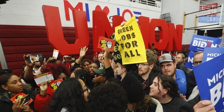 Protesters disrupt a Democratic presidential candidate former Vice President Joe Biden campaign rally at Renaissance High School in Detroit, Monday, March 9, 2020. (AP Photo/Paul Sancya)