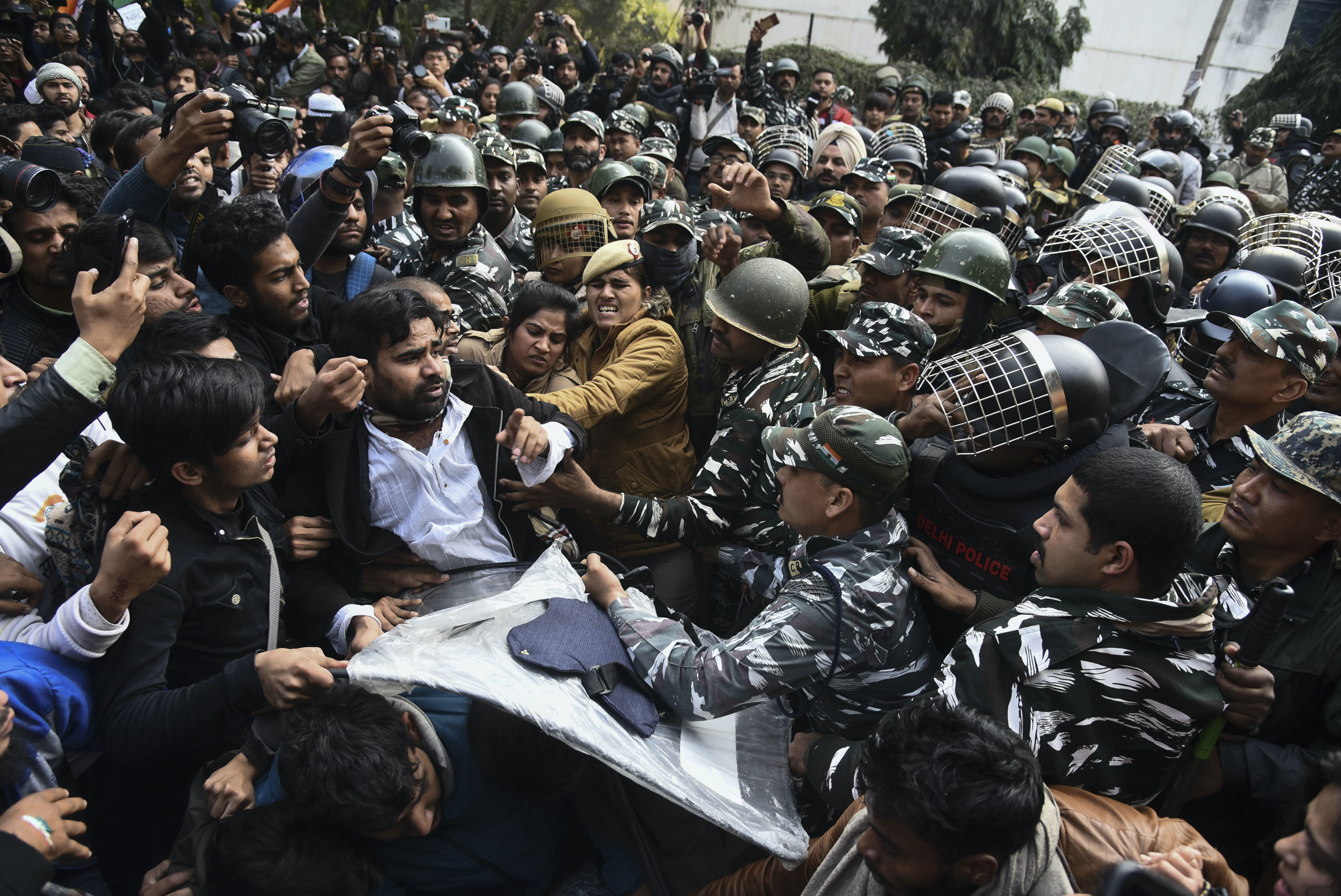 Students and police face off during a protest against a new citizenship law outside the Jamia Millia Islamia university in New Delhi, India, Monday, Feb.10, 2020. Over the past two months India has been witnessing continuing protests against a new citizenship law that excludes Muslims. (AP Photo)