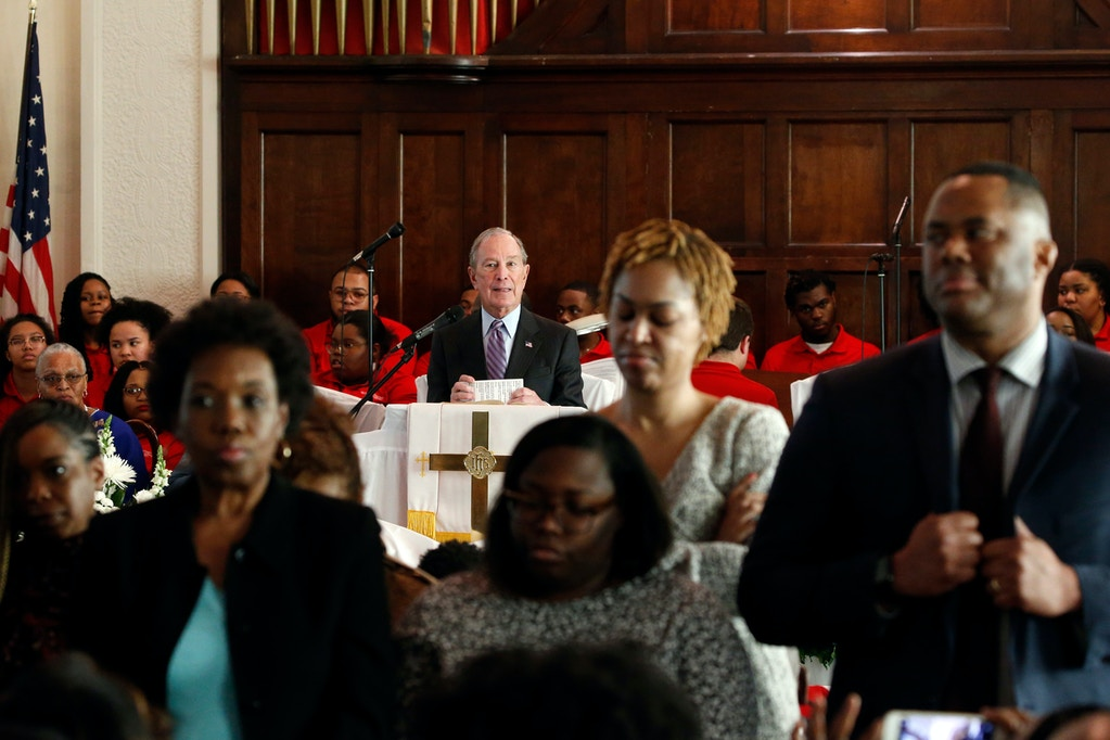 People turn their backs on Democratic presidential candidate and former New York City Mayor Mike Bloomberg as he speaks at Brown Chapel AME church, Sunday, March 1, 2020, in Selma , Ala. (AP Photo/Butch Dill)