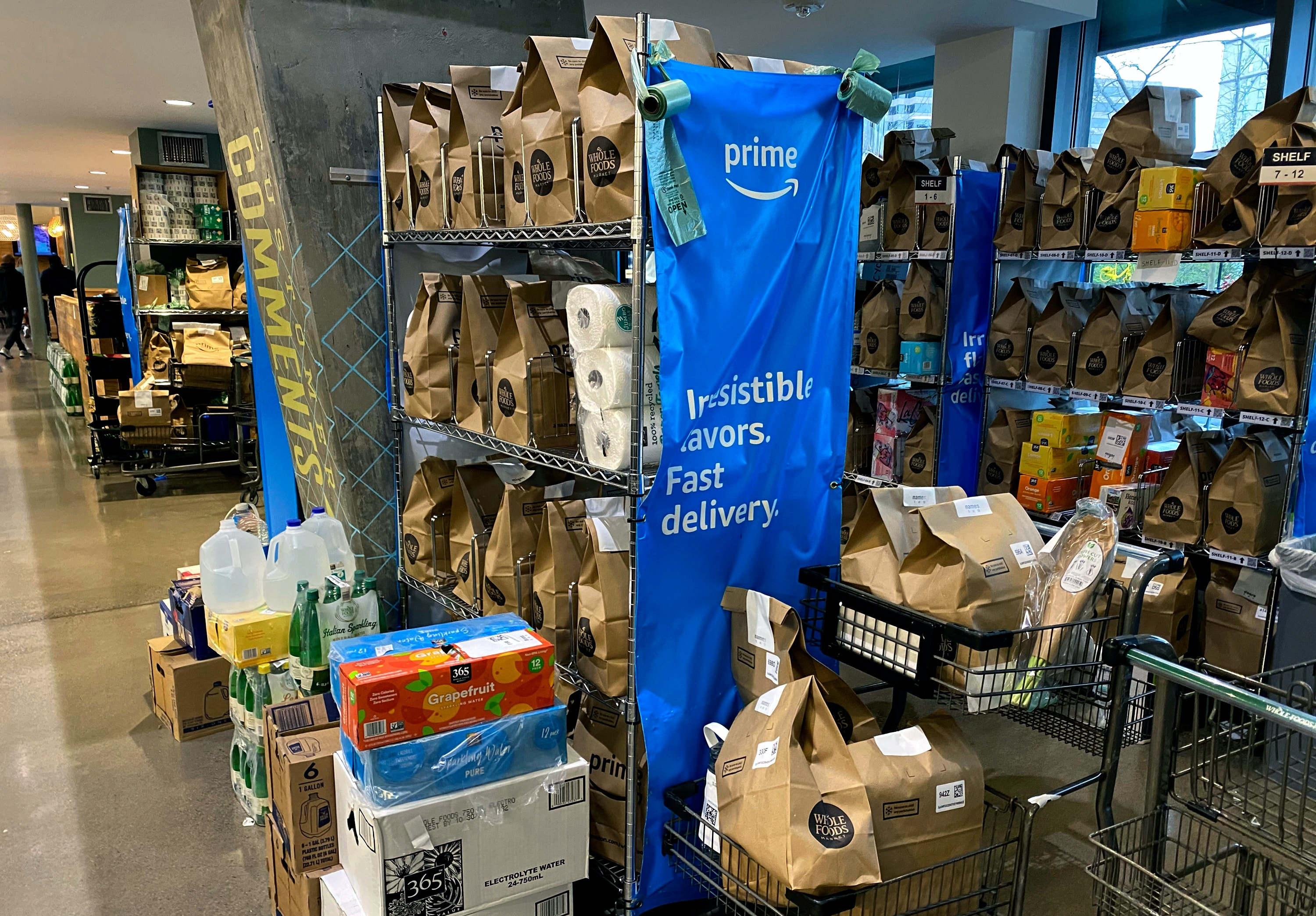 PENTAGON CITY, VA- MARCH 15: View of Amazon Prime orders waiting on delivery at a Whole Foods as COVID-19 pandemic has led to a backlog of orders due to no drivers in Pentagon City, Virginia on March 15, 2020. Credit: mpi34/MediaPunch /IPX