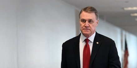 Sen. David Perdue, R-Ga., heads into a Republican policy lunch on Capitol Hill in Washington, Thursday, March 19, 2020. (AP Photo/Susan Walsh)