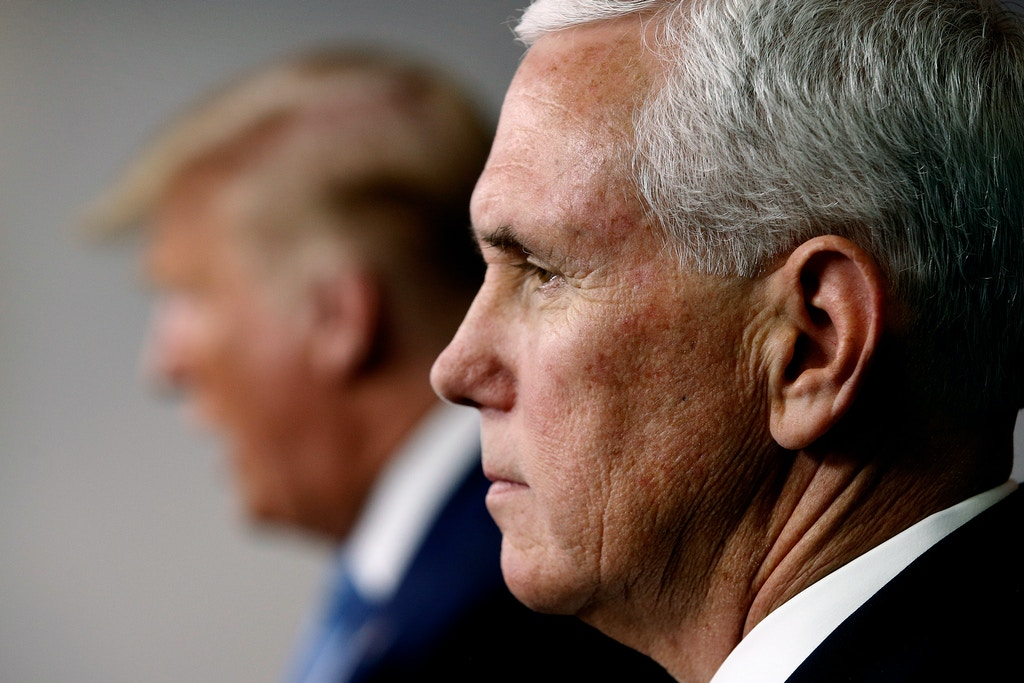 Vice President Mike Pence listens as President Donald Trump speaks during a coronavirus task force briefing at the White House, Saturday, March 21, 2020, in Washington. (AP Photo/Patrick Semansky)