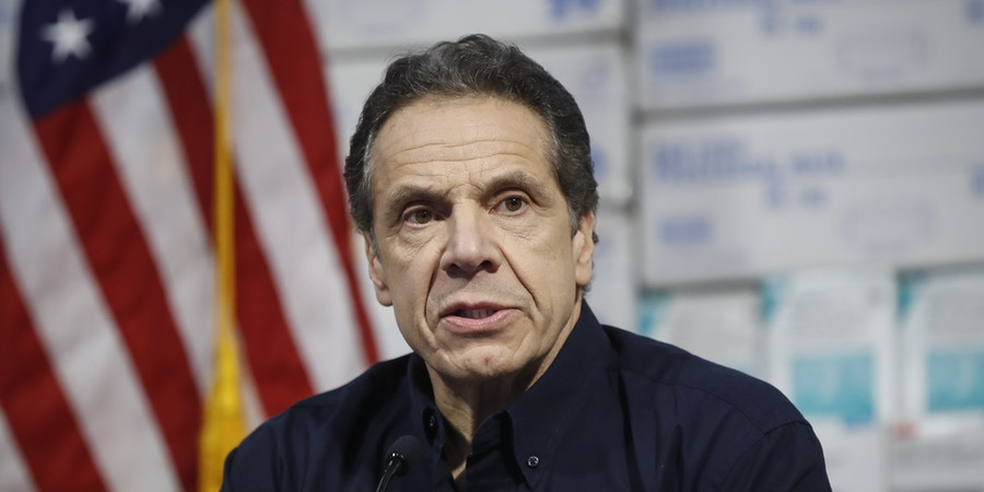 New York Gov. Andrew Cuomo speaks during a news conference against a backdrop of medical supplies at the Jacob Javits Center that will house a temporary hospital in response to the COVID-19 outbreak, Tuesday, March 24, 2020, in New York. Cuomo sounded his most dire warning yet about the coronavirus pandemic, saying the infection rate in New York is accelerating and the state could be as close as two weeks away from a crisis. (AP Photo/John Minchillo)