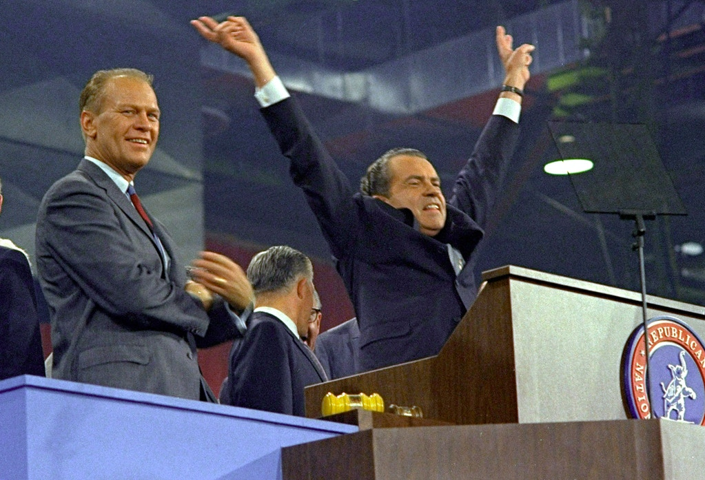 Republican presidential nominee Richard Nixon raises his arms in victory after accepting his party's nomination at the Republican Convention in Miami in this Aug. 8, 1968 file photo. At left is House Republican Leader Gerald Ford. Former first lady Betty Ford said Tuesday Dec. 26, 2006, that President Gerald Ford has died.(AP Photo/File)