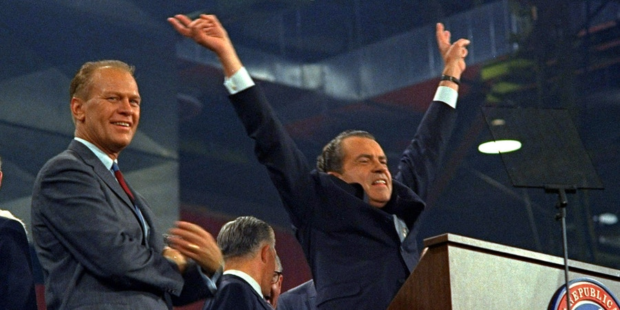 **FILE ** Republican presidential nominee Richard Nixon raises his arms in victory after accepting his party's nomination at the Republican Convention in Miami in this Aug. 8, 1968 file photo.  At left is House Republican Leader Gerald Ford. Former first lady Betty Ford said Tuesday Dec. 26, 2006, that President Gerald Ford has died.(AP Photo/File)