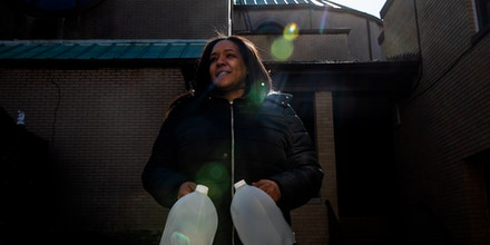 NEWARK, NJ. - FEBRUARY 22, 2020: Local resident, Anna, Hollaway,at the water distribution center in St. LucyÕs Rectory Church in Newark, NJ. CREDIT: Demetrius Freeman for The Intercept