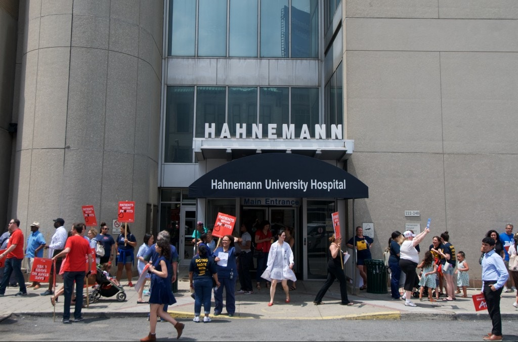 Protestors march around the building after a rally with Bernie2020 campaign co-chair Sen. Nina Turner to protest the the imminent closure of Hahnemann University Hospital in Philadelphia, PA on July 11, 2019. The struggling Center City located hospital announced it will seize operations and is facing out critical services like Emergency access and the maternity ward unless support is found to end the financial turmoil (Photo by Bastiaan Slabbers/NurPhoto via Getty Images)