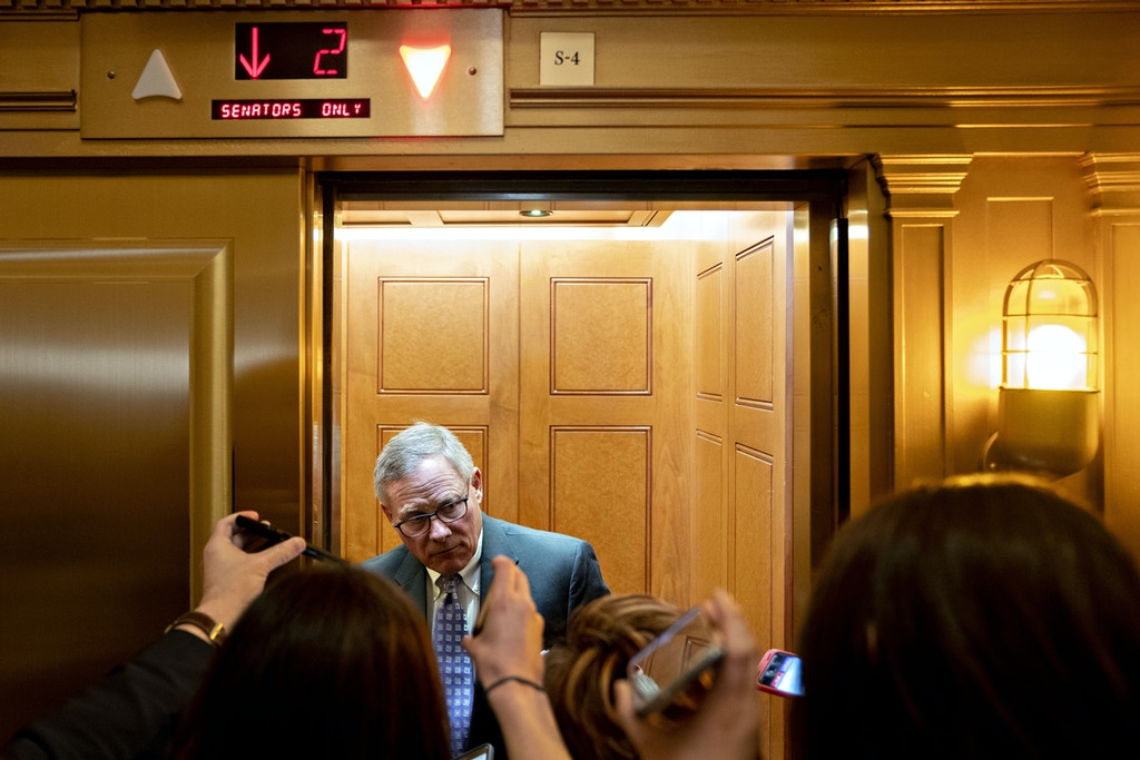 Senator Richard Burr, a Republican from North Carolina, speaks to members of the media while standing on an elevator at the U.S. Capitol in Washington, D.C., U.S., on Tuesday, Feb. 4, 2020. The biggest mystery left in Donald Trump's inevitable impeachment acquittal is whether any Democrats will join Senate Republicans to give him a bipartisan vote to clear him of the Houses charges. Photographer: Andrew Harrer/Bloomberg via Getty Images
