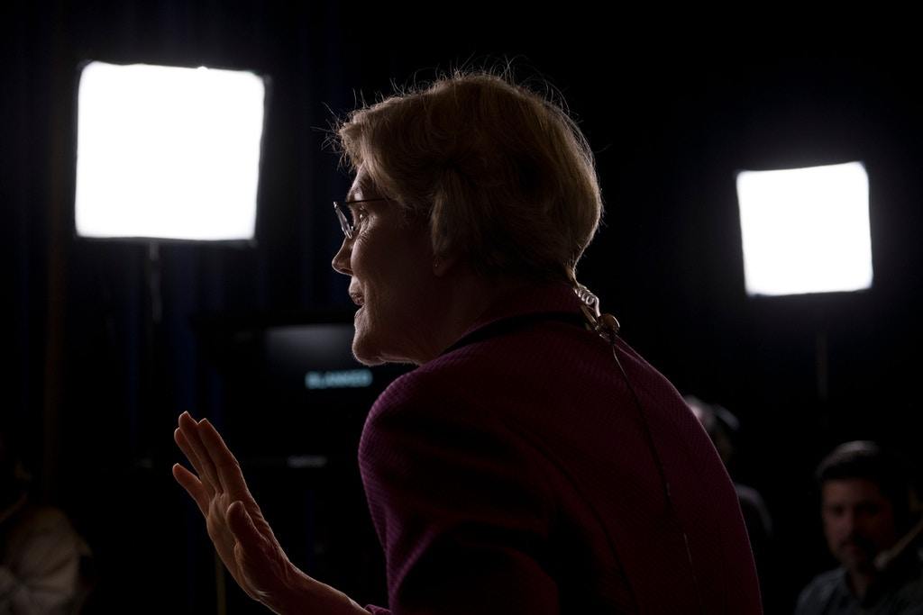Sen. Elizabeth Warren speaks to media in the spin room following the ninth Democratic primary debate in Las Vegas, Nev., on Feb. 19, 2020.