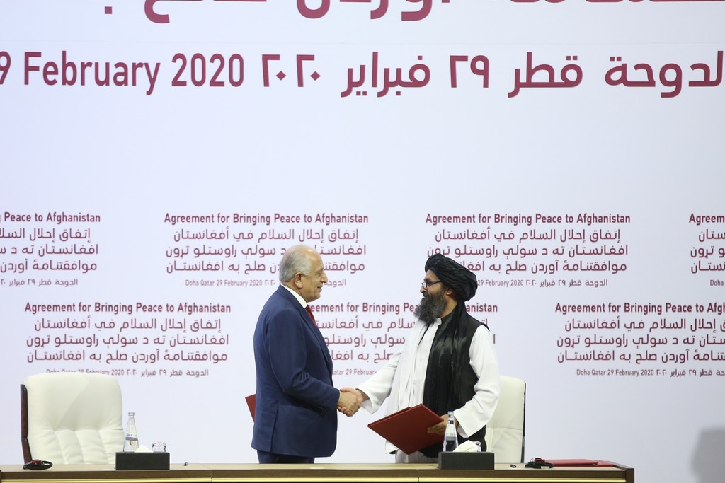 QATAR, DOHA - FEBRUARY 29: US Special Representative for Afghanistan Reconciliation Zalmay Khalilzad (L) and Taliban co-founder Mullah Abdul Ghani Baradar (R) shake hands after signing the peace agreement between US, Taliban, in Doha, Qatar on February 29, 2020. (Photo by Fatih Aktas/Anadolu Agency via Getty Images)
