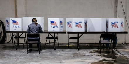 Voters cast ballots at a polling station in Whitmore Lake, Michigan, U.S., on Tuesday, March 10, 2020. Democratic presidential candidate Joe Biden argued Monday that voters in economically distressed places are not looking for the broader