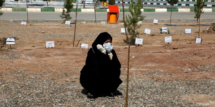A woman mourns during a funeral held at Beheshte Masoumeh Cemetery for the victims of the new coronavirus in Qom, Iran, on March 17, 2020.