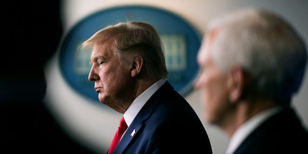 U.S. President Donald Trump listens during a Coronavirus Task Force news conference in the briefing room of the White House in Washington, D.C., U.S., on Wednesday, March 18, 2020. Trump invoked the Defense Production Act, allowing the government to boost production of masks and protective equipment. Europe surpassed China in the number of coronavirus infections. Photographer: Kevin Dietsch/UPI/Bloomberg via Getty Images