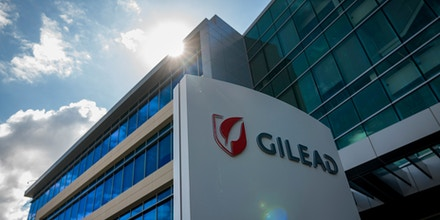 Signage is displayed outside Gilead Sciences Inc. headquarters in in Foster City, California, U.S., on Thursday, March 19, 2020. Gilead Sciences stock jumped as much as 7% on Thursday, reaching a two-year high, as a Piper Sandler analyst doubled down on his call on the approval prospects for the biotech company's experimental therapy for the pandemic now sweeping the U.S. Photographer: David Paul Morris/Bloomberg via Getty Images