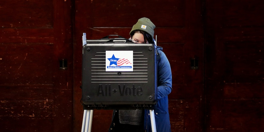 CHICAGO, ILLINOIS - MARCH 17: A voter casts a ballot in the primary election at Columbus Grade School on March 17, 2020 in Chicago, Illinois. Illinois, Ohio Arizona and Florida were scheduled to hold elections today but Ohio cancelled citing a health emergency posed by COVID-19.  (Photo by Scott Olson/Getty Images)